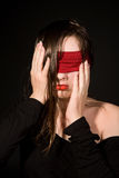 Young woman with  bandage on her eyes Royalty Free Stock Image