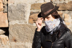 Young woman bandit doffing her hat Stock Images