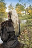 The young woman on the bank of the forest lake.  stock images