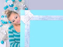 Young woman with banner in christmas interior Royalty Free Stock Image