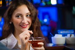 Young woman in a bar Stock Photography