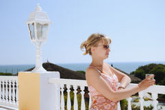Young woman in the bar by the sea Stock Image