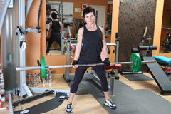 Young woman with barbell Stock Images