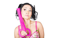 Young woman barber holding large pink scissors Royalty Free Stock Photos
