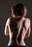Young woman bare back stock photos