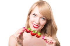 Young woman with bare shoulders holding ripe strawberry. Portrait of young woman with bare shoulders holding ripe strawberry Stock Image
