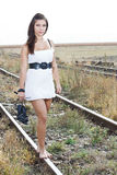 Young woman barefeet on rail Royalty Free Stock Image