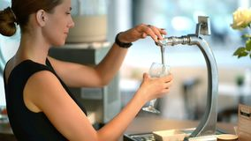 Pouring Draft Beer. Young woman bartender pouring draft beer stock video footage