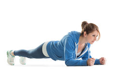 Young woman in basic plank posture Stock Photos