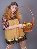Young woman  with a basket of apples Stock Photos