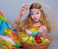 Young woman with a basket of apples Stock Photography