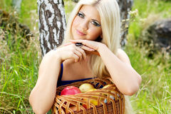 Young woman with basket of apples Stock Photo