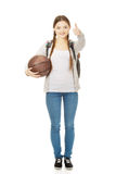 Young woman with basket ball. Stock Photo