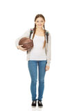 Young woman with basket ball. Stock Photography