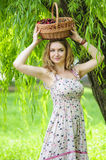 Young woman with a basket of cherries Royalty Free Stock Photography