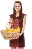 Young woman with a basket of corn Stock Photo