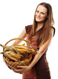 Young woman with a basket of corn Royalty Free Stock Images