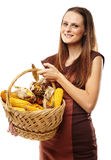 Young woman with a basket of corn Stock Photography