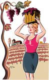 Young woman with a basket filled with freshly picked ripe grapes. In the vineyard Stock Image