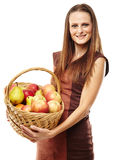 Young woman with a basket of fruits Stock Image