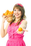 Young woman with a basket full of tangerines Stock Photo