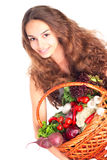 Young woman with basket of vegetables Royalty Free Stock Photography