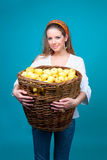 Young woman with basket of yellow apples Stock Photos