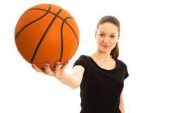Young woman with basketball. Isolated Royalty Free Stock Photo