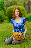 Young woman with baskets of fruit Royalty Free Stock Images
