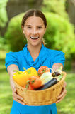 Young woman with baskets of fruit Royalty Free Stock Photography