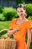 Young woman with baskets of fruit and vegetables Royalty Free Stock Photography