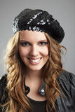 Young woman with basque cap Royalty Free Stock Photos