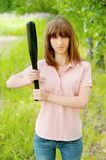 Young woman with bat Royalty Free Stock Photography