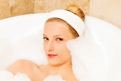A young woman in the bath Royalty Free Stock Image