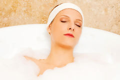 A young woman in the bath.  Stock Photo