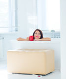 Young woman in bath with drink Royalty Free Stock Photo