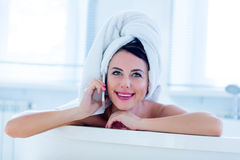 Young woman in bath with phone Stock Photography