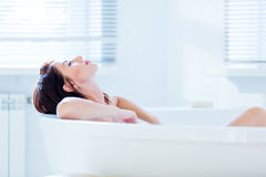 Young woman in bath Stock Photo