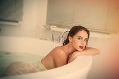 Young woman in bath Stock Image
