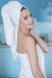 Young Woman in Bath Towel Looking Over Shoulder. Sexy Young Woman in Bath Towel Looking Over Shoulder at Camera  Waist Up Stock Photos