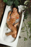 Young woman in a bath-tub (from above) Stock Photos