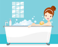 Young Woman Bathing In Bathtub, In Bathroom Royalty Free Stock Image