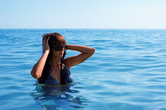 Young woman bathing in sea Stock Images