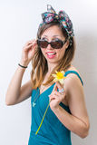 Young woman in bathing suit holding a flower Stock Images