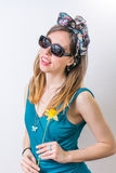 Young woman in bathing suit holding a flower Stock Photos