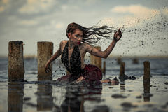 Young woman bathing in therapeutic water of mud estuary. stock photography