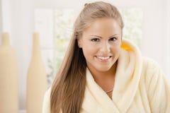Young woman in bathrobe Stock Photo