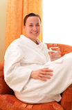 Young woman in bathrobe Royalty Free Stock Images