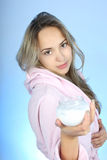 Young woman in bathrobe with cream after bath Royalty Free Stock Photography