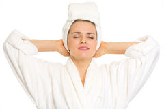 Young woman in bathrobe enjoying freshness Stock Photos